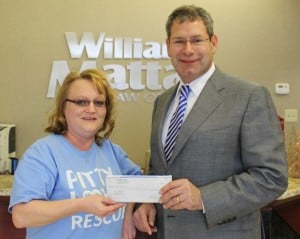 William Mattar presents shelter donation to Kerri Saxer of Pitty Love Rescue
