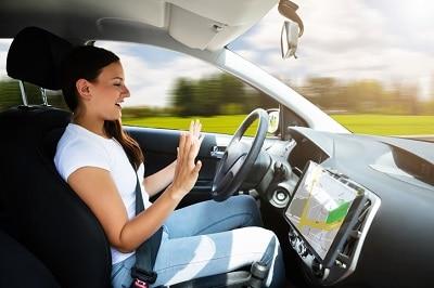 woman sitting in self driving car