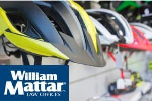 How do bicycle helmets protect the head in an accident