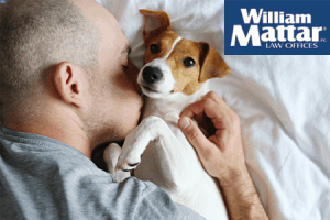 Man embracing pet dog for comfort