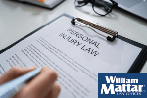 Document on clip board about personal injury law