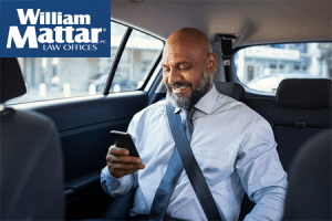 Adult back seat passenger wearing a seatbelt
