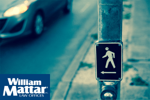 pedestrian crossing sign at crosswalk