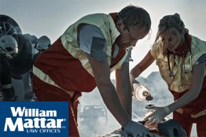 emergency responders treating car accident victim