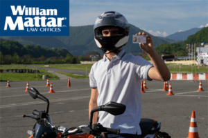 Motorcyclist holding a license
