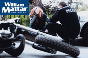 INjured motorcyclist speaking with police