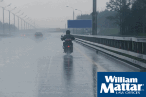 motorcycle traveling in the rain